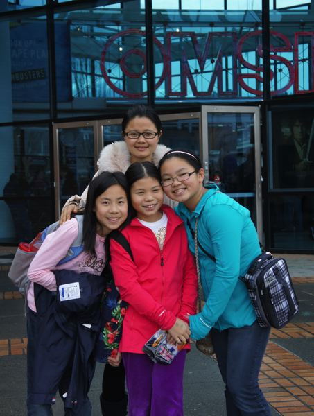 by: PHOTO COURTESY: CASCADE HEIGHTS - Chinese Exchange Teacher, Fei Fei Song, with Yimin Li, and Malia and Meiling Masterson in front of OMSI.