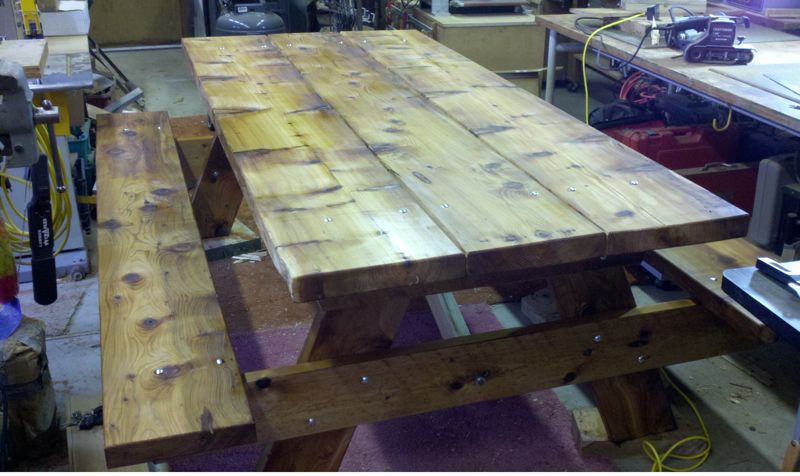 by: PHOTO COURTESY: NORTH CLACKAMAS CHRISTIAN SCHOOL - Starting with a 3-foot-wide tree, Dave Hayes built a 8-foot-long picnic table with boards 3 inches thick.