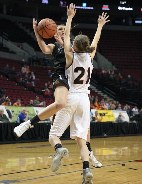 by: MILES VANCE - Oregon City junior Jessica Gertz goes on the attack in Oregon Citys 70-53 quarterfinal win over Beaverton. Freshman Emma Kennedy (21) defends for the Beavers.