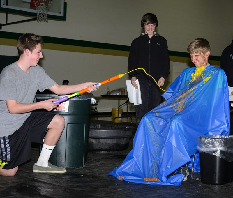 by: NEWS-TIMES PHOTO: CHASE ALLGOOD - Josh Davis of Gaston High School let people spray him with everything from ketchup to  mustard to whip cream and more in order to raise money for his baseball teams tournament trip.