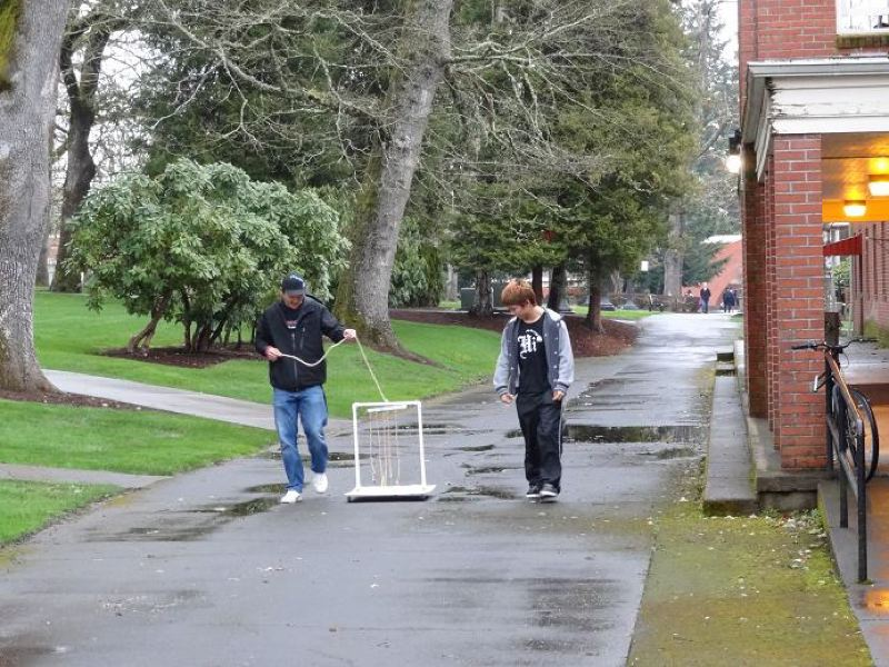 by: COURTESY PHOTO: DEB BOUCHETTE - Pacific University art students take their mini-Chaucer machine for a walk so it can record the choreography of their trip.