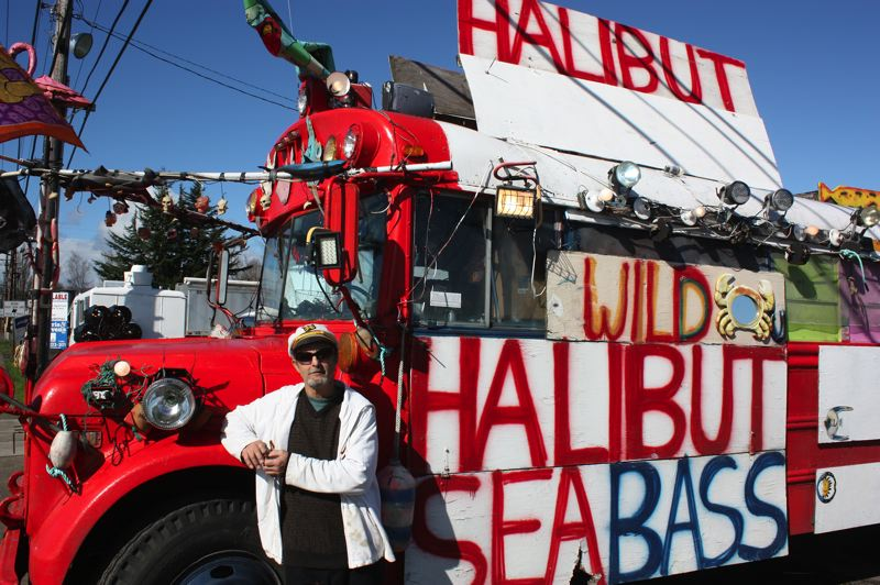 by: NEWS-TIMES PHOTO: DOUG BURKHARDT - Jonny Rush does not have any trouble attracting attention as he goes from town to town in Oregon selling fresh-frozen fish from an old school bus he has appropriately named The Red Bus.
