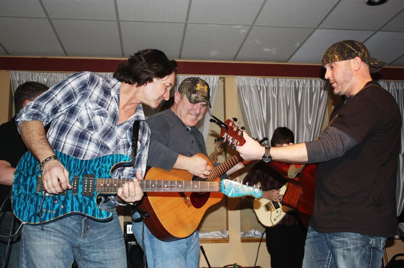 by: NEWS-TIMES PHOTO: DOUG BURKHARDT - Kurt Van Meter (right) jams with band members Dave Morse (center) and lead guitarist Stewart Marsh during Fridays benefit dance for the Cannon family at the Hillsboro Elks Lodge.