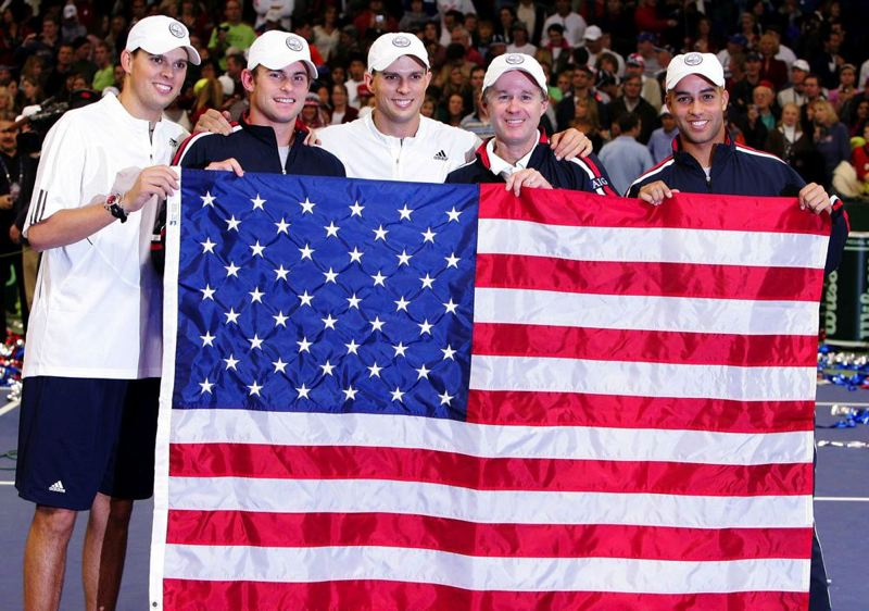 by: JONATHAN FERREY/GETTY IMAGES - The 2007 U.S. Davis Cup team of (from left) Bob Bryan, Andy Roddick, Mike Bryan, captain Patrick McEnroe and James Blake celebrates winning the Davis Cup at Memorial Coliseum.