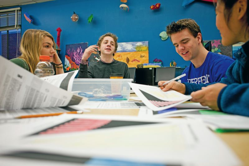 by: CHRISTOPHER ONSTOTT - Cleveland High School students Sarah Stone (from left), Darius Capizzi, Zach Frentress, Hadley Sternber and Jenny Retchless tackle ways to stabilize global carbon emissions during a group lab project. Not all schools are as dlligent about addressing this pressing environmental problem.