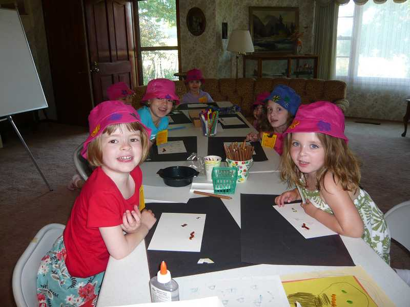 by: SUBMITTED PHOTO - Campers in the Springtime Girls Camp enjoys arts and crafts as well as other activities.