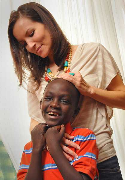 by: REVIEW, TIDINGS PHOTOS: VERN UYETAKE - Shelley Perry brought home her adopted son, Endrias, just before Christmas last year. Because of Endrias, Perry is now reaching out to the nation of Ethiopia.