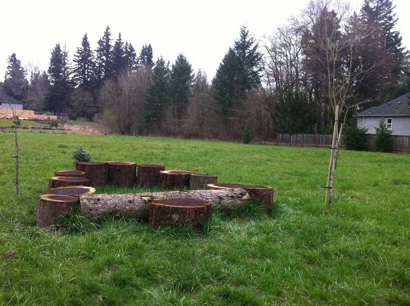 by: SHERI RICHARDS - The newly established park in Rivergrove lives up to its name, Heritage Park, with a section of a Giant Sequoia tree from a nearby lot repurposed to provide a nature play area for children.