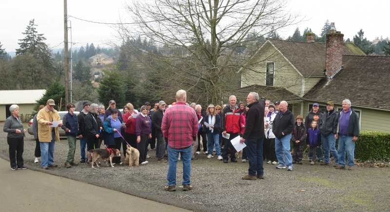 by: MIKE WATTERS - Hikers stopped at the oldest house in West Linn on March 2 as part of the city's Centennial Heritage Walks series.