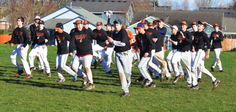 by: JOHN BREWINGTON - A chorus line. Scappoose baseball players loosen up with some foot drills during practice last week. The Indians are young this year, but still figure to be a factor in the Cowapa League race. Scappoose is the defending league champion, winning their first title since 1995 last season.