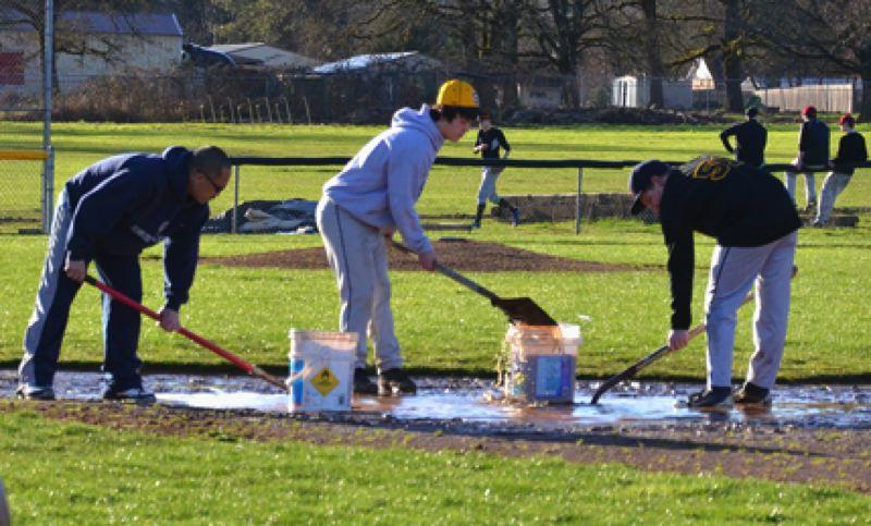 by: JOHN BREWINGTON - One of the first orders of business last week was to get the St. Helens High baseball field playable. It took days, but the field is now ready to go for the team's first home game.