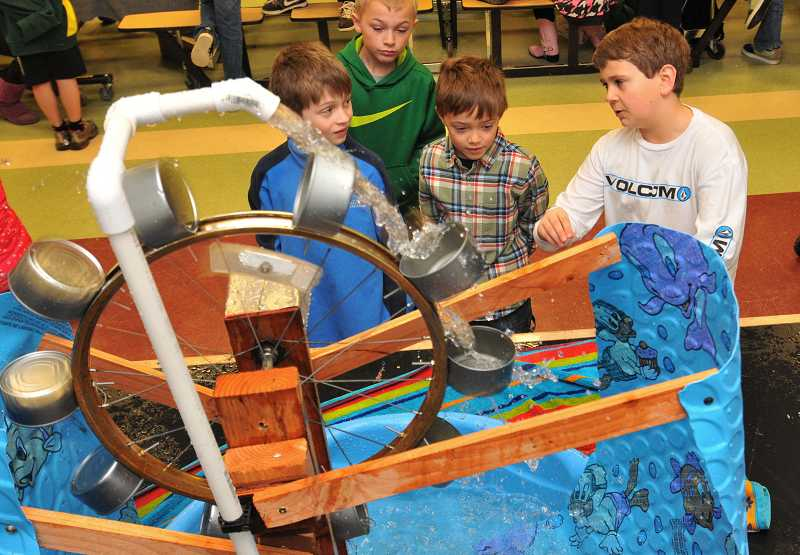 by: TIDINGS PHOTO: VERN UYETAKE - Stafford fifth-grader Jacob Huttula, right, discusses his water wheel with, from left, C.J. Anthonucci, Ian Hansen and Liam Hill.