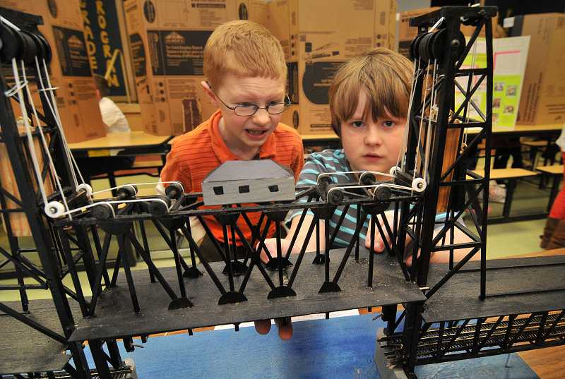 by: TIDINGS PHOTO: VERN UYETAKE - William Alexy, on right, fourth grade, explains his model of the Portland Steel Bridge with Jacob McClelland.