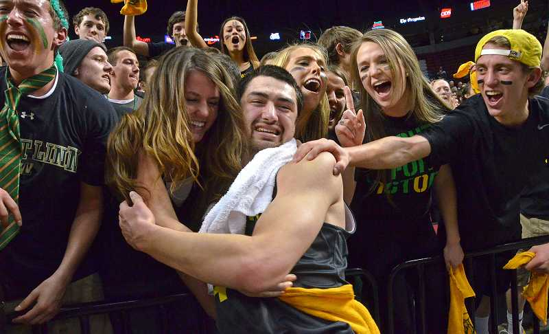 by: VERN UYETAKE - The crowd mobs West Linn junior Ryan Sheamire after the boys basketball team won the state championship on Saturday.