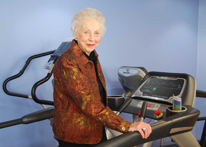 by: SUBMITTED - Floetta Ide stands on one of the treadmills she donated to the rehab center.