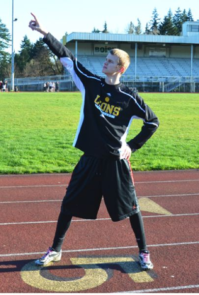 by: JOHN BREWINGTON - St. Helens' Jared Bonney indicates how high he might high jump this season or he could just be pointing at an airplane.