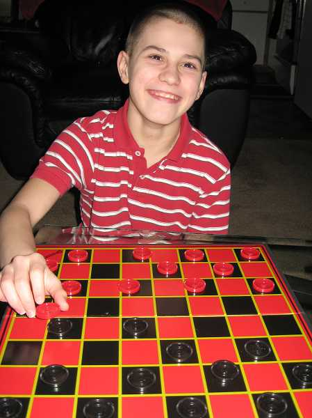 by: SUBMITTED PHOTO - Tristen, who has been in foster care about six years, plays a great game of checkers and says hes good at chess, too.