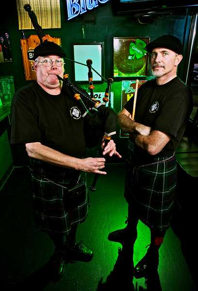 by: TIMES FILE PHOTO: JAIME VALDEZ - Tualatin Valley Fire & Rescue Pipes and Drums Band, including Tim Birr and Brad Smith, will perform at several St. Patricks Day celebrations this weekend.