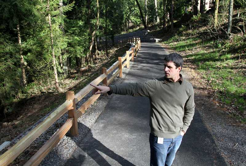 by: TIMES PHOTO: JONATHAN HOUSE - Tualatin Hills Park and Recreation District planner Tim Bonnin talks about the design and planning involved with bring Jordan Woods Natural Area to fruition.