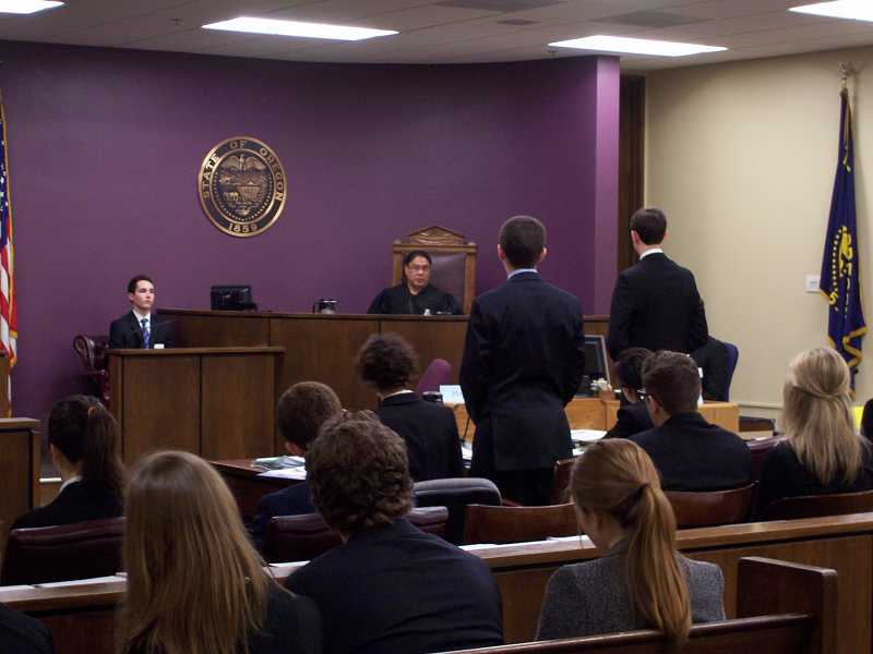 by: SUBMITTED - Lake Oswego High School's White Team duked it out with Sandy High School's Red Team at the mock trial regionals earlier this month.