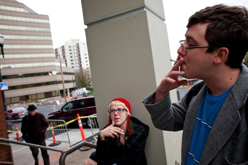 by: TRIBUNE PHOTO: CHRISTOPHER ONSTOTT - PSU student Alexander Bersani smokes outside the Unitus building on campus down town before heading into class. PSU plans to ban smoking on campus.