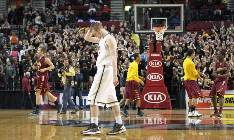 by: MILES VANCE - TOUGH RESULT - Jesuit's Daniel Nelson walks off the court in disbelief after his team's 45-37 loss to Central Catholic in the semifinals of the Class 6A state tournament on Friday at the Rose Garden.