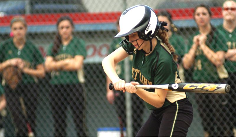 by: PAMPLIN MEDIA GROUP: DAVID BALL - West Linn's Carly Savoy takes a swing during Wednesday's 12-2 win at Centennial.