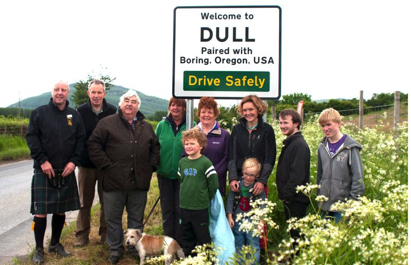 by: CONTRIBUTED PHOTO: JASON O'FLYNN - CONTRIBUTED PHOTO: JASON O'FLYNN Nearly 15 percent of the residents of Dull, Scotland, gathered to be photographed under one of two new road signs near Dull. This photo-op occurred in late June 2012 following the sign-unveiling ceremonies. Some Boring residents would like to have a similar sign at the edge of the community park.