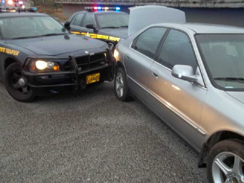 by: SUBMITTED PHOTO - Two Oregon State Police cars pursued a stolen Honda sedan which had attempted to elude police on the Interstate 5 from Salem.