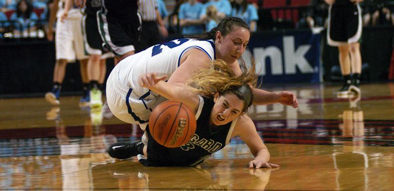 by: DAN BROOD - FLOOR BURNS -- Tigard High School junior guard Emilee Cincotta, in front of South Medford senior Kylie Towry, dives for a loose ball during Friday's semifinal game at the Class 6A state tournament. The Tigers were edged 35-31.