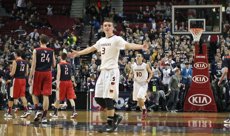 by: MILES VANCE - No way! Southridge senior Caleb Dozier appeals to game officials after a call went against the Skyhawks late in their quarterfinal loss to Lake Oswego in the Class 6A state tournament at the Rose Garden on March 6.