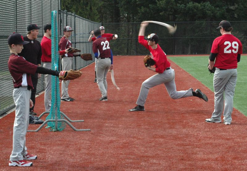 by: SANDY POST: PARKER LEE - Sandy pitchers work out on the teams new artificial fields.