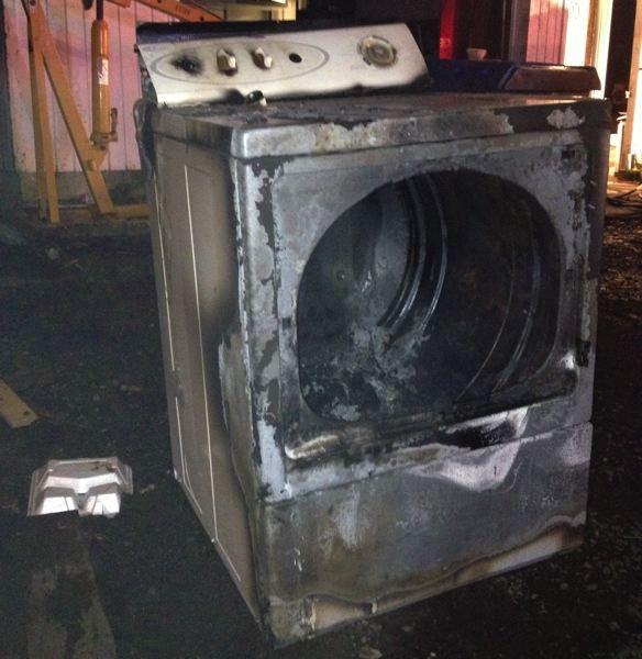 by: PHOTO COURTESY: CLACKAMAS FIRE DISTRICT NO. 1 - No much is left of this Oak Grove family's dryer after a fire ravaged it on March 17.