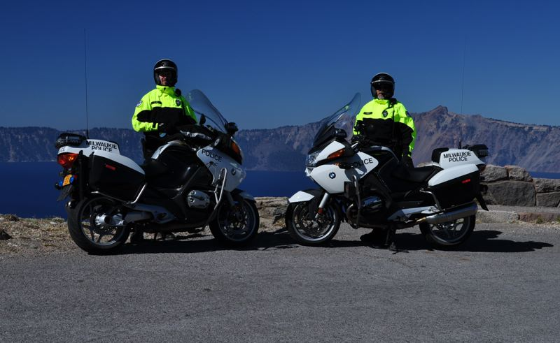 by: PHOTO COURTESY: MILWAUKIE POLICE DEPARTMENT - Milwaukie police officers John Downey (right) and Zane Odem at Crater Lake on duty as  providing security for 2,000-plus Cycle Oregon participants in September 2012.