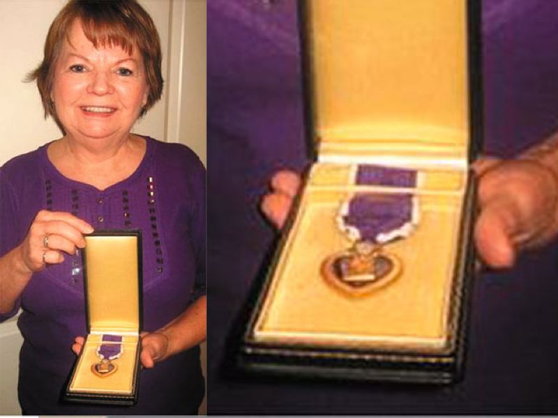 by: JOHN BAKER - Rhonda Stone found a WWII soldier's purple heart in a storage auction. She helped to return the medal to the soldier's family.