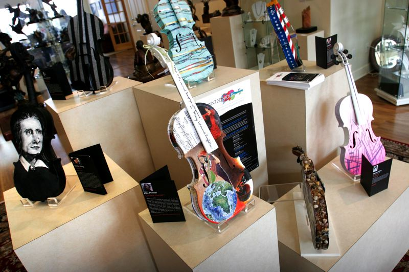 by: OUTLOOK PHOTO: JIM CLARK - A collection of painted violins is on display at Caswell Gallery in Troutdale. The violins will be sold at auction to benefit the Portland Youth Philharmonic.