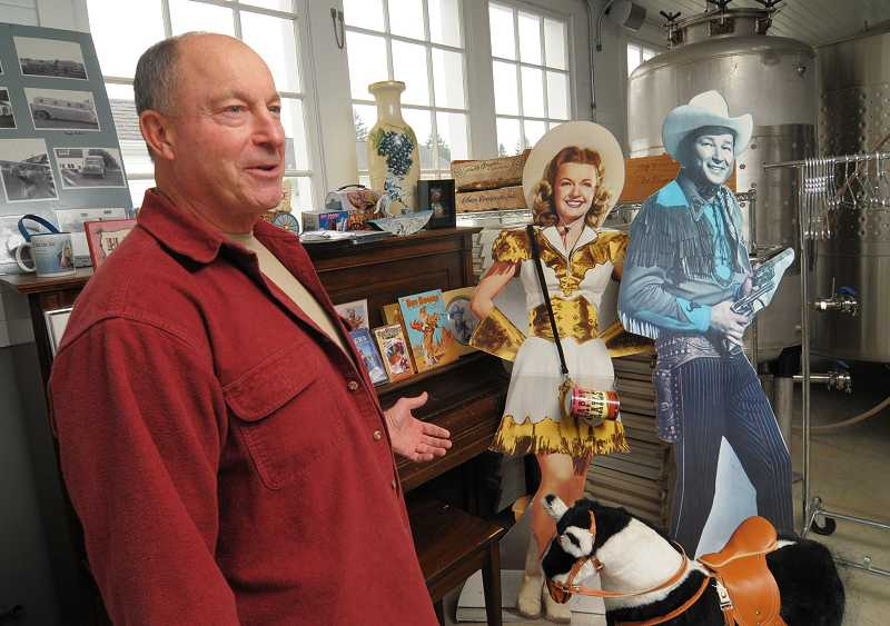 by: REVIEW, TIDINGS PHOTOS: VERN UYETAKE - Jerry Marshall proudly exhibits cutouts of Roy Rogers and Dale Evans. Marshall got the cutout of Roy from a grocery store, but the cutout of Dale just showed up one day.