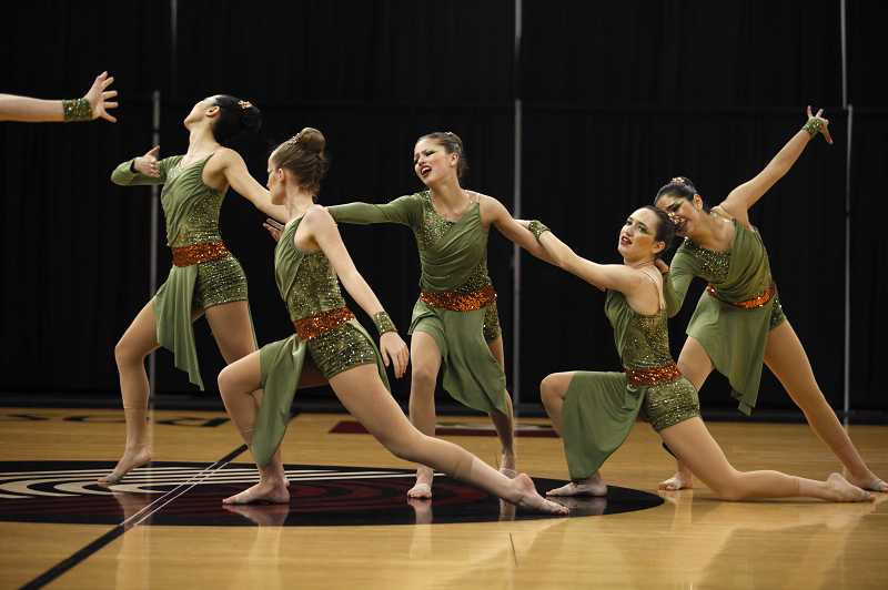 by: TIMES PHOTO: JONATHAN HOUSE - Charisma dancers from Valley Catholic High School perform their piece 'The Hunt' during the OSAA State Dance Championships on March 13 at Memorial Coliseum. Charisma took first place in the Class 3A/2A/1A division for the fourth consecutive time.