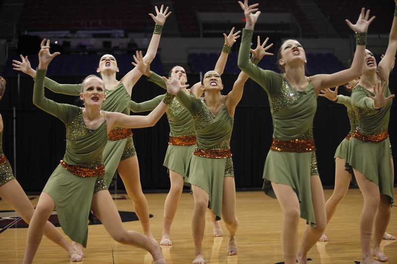 by: TIMES PHOTO: JONATHAN HOUSE - Charisma dancers from Valley Catholic High School perform their piece The Hunt during the OSAA State Dance Championships on March 13 at Memorial Coliseum. Charisma took first place in the Class 3A/2A/1A division for the fourth consecutive time.