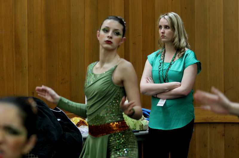 by: TIMES PHOTO: JONATHAN HOUSE - Charisma head coach Jessica Anderson watches her dancers prepare prior to their performance. The Dance and Drill Association later honored Anderson as Coach of the Year.
