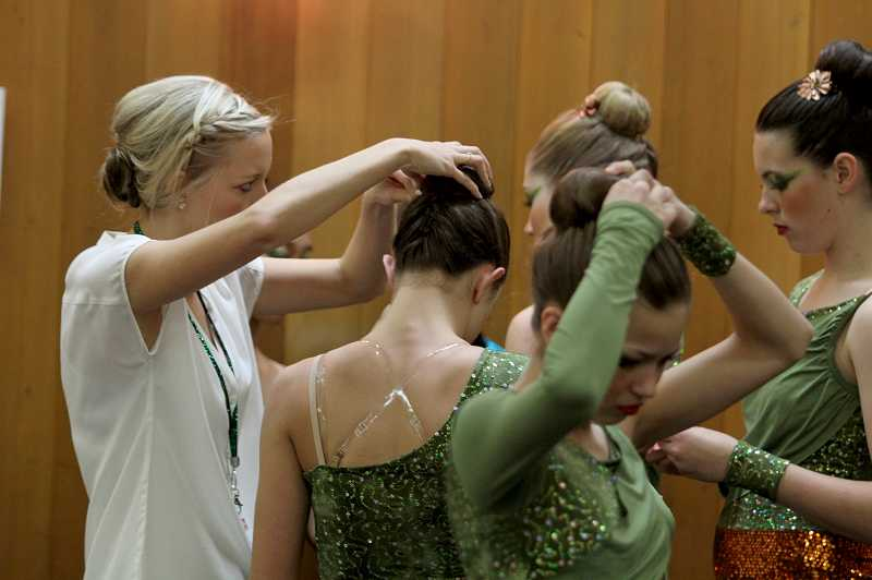 by: TIMES PHOTO: JONATHAN HOUSE - Charisma dancers prepare prior to their performance in the state championships.