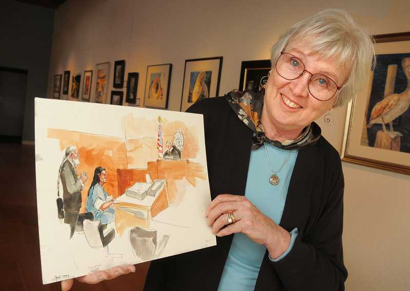 by: VERN UYETAKE - Deborah Marble shows art she was hired to create during a 2008 federal court hearing involving Tre Arrow, an environmental activist who pleaded guilty to charges of arson.