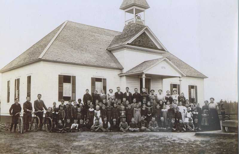 by: SUBMITTED PHOTO - The book is told primarily through archival photographs, including this photo of East Butte School in 1896 on the land where Charles F. Tigard Elementary School stands today. Tigard was originally known as East Butte in the 1890s before the name was changed to Tigard.