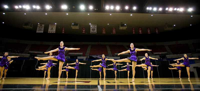 by: JAMES MCGREW - Lake Oswego High School students leaped, whirled and high-kicked through their routine, taking home first place in their division during the 2013 OSAA Dance and Drill State Championships March 13-16.