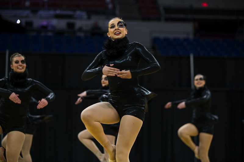 by: CHRISTOPHER ONSTOTT - Lakeridge High School junior Megan Johansen takes the floor with her team during the OSAA state competition.