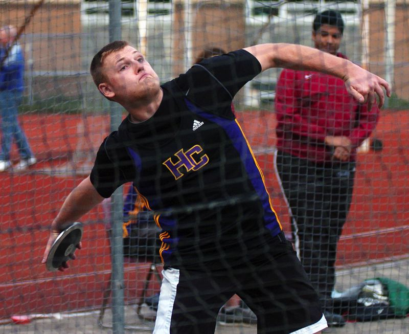 by: DAN BROOD - WINNING FORM -- Horizon Christian senior Grant Phillips is ready to set sail with the discus during last week's meet at West Linn. Phillips won both the discus and the shot put events at the meet.