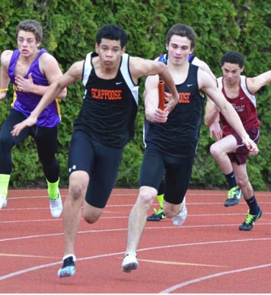 by: JOHN BREWINGTON - Flying exchange. Scappoose's Paul Revis hands off to Jadyn Harris on a way to a win in the 4x100 relay at the Anderson Relays last week. The Indians are looking quite strong this season and have their sights set on a trophy at the 4A state meet.