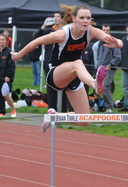 by: JOHN BREWINGTON - Scappoose's Phlycia Haigh ran a nice leg of the shuttle hurdles during last week's Anderson Relays in Scappoose.