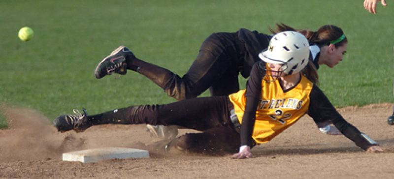 by: DAN BROOD, PAMPLIN MEDIA GROUP - Safe at second. St. Helens' Sue Sass slides safely into second base during last Monday's game with Tigard. The Lady Lions posted their second win in three outings, downing Tigard, 10-6. The squad is considered one of the premier teams in the 5A ranks.
