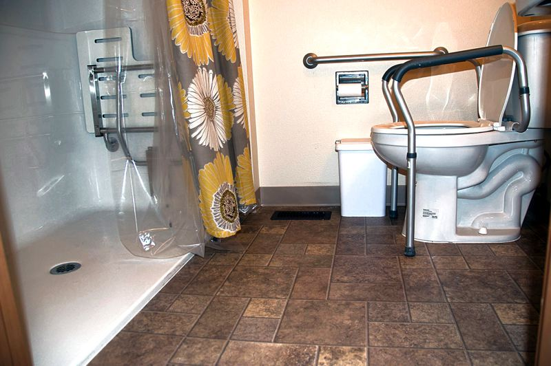 by: PHOTOS COURTESY OF REFIT - Bathrooms can be dangerous places for people with limited mobility. This bathroom has been retrofitted by ReFit's volunteer contractors to make it safe and accessible.